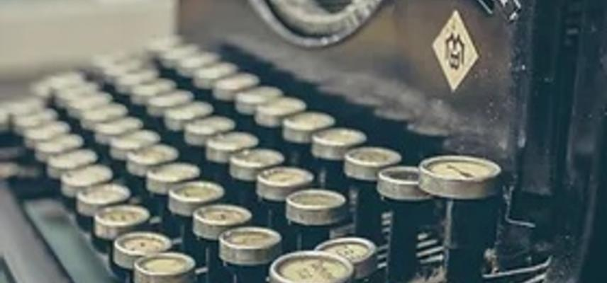 A closeup of the keys of an antique typewriter.